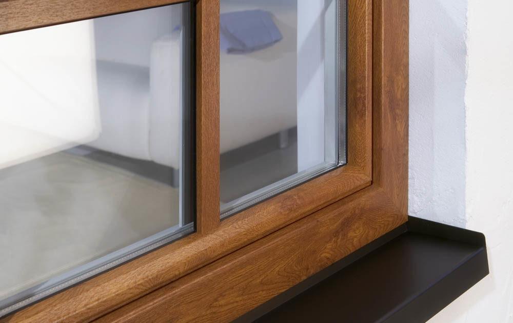 Ventana Cálida PVC imitación madera con barrotillos